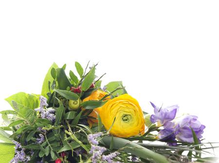 close p: green bouquet with yellow buttercups and lilac freesias, floral border, isolated