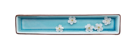 blue daisy: rectangular blue bowls with water and white flowers,spa,isolated on white background