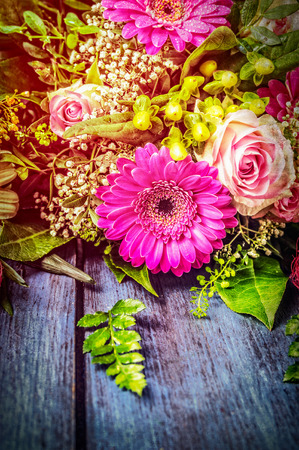 blue daisy: Flowers bunch with gerbera and roses on blue wooden background, textured