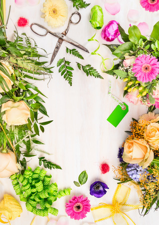 Florist workplace with retro scissors, and  accessories on white wooden background, top view,place for text