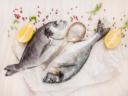 dorado fish: Dorado fish composing with lemon, spices and salt, top view