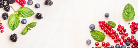 fresh: Fresh summer berries, corner frames on white wooden background, top view, banner for website