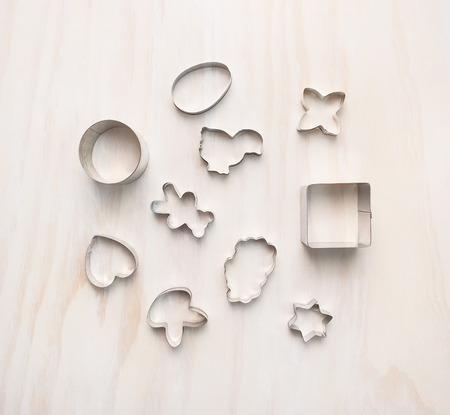cookie cutter: easter cookie cutter composing on white wooden, background, top view Stock Photo