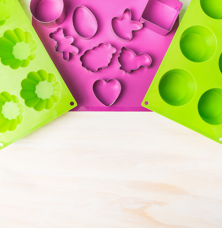 easter cookie: Easter cake mold with cookie cutter on white wooden background, top view, place for text Stock Photo