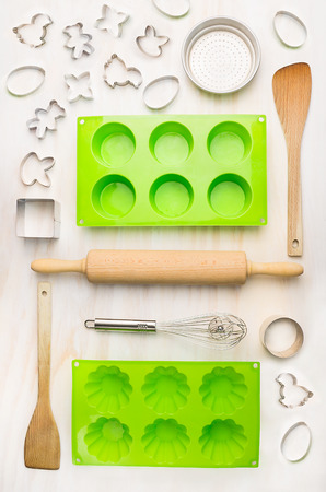 cookie cutter: cake mold and tools for muffin, cupcake and cookie bake on white wooden background, top view