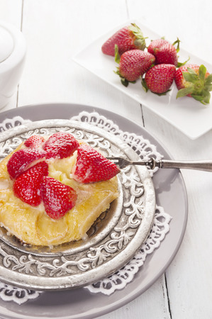 pastry cake with strawberries and pudding photo