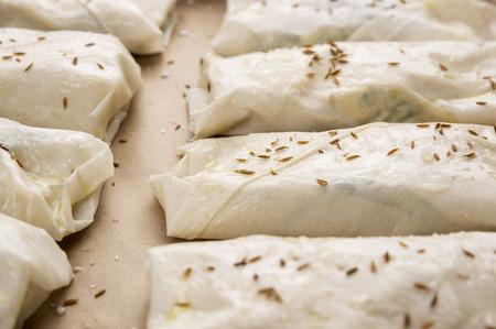 yufka: preparation of filo puff pastry pies,Turkish cuisine Stock Photo