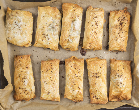 yufka: plate with baked puff pastry pies,top view Stock Photo