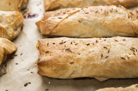 yufka: baked puff pastry pies with filo pastry on plate, close up