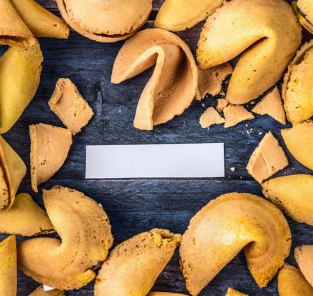 good fortune: Open fortune cookie with empty blank paper, top view, close up