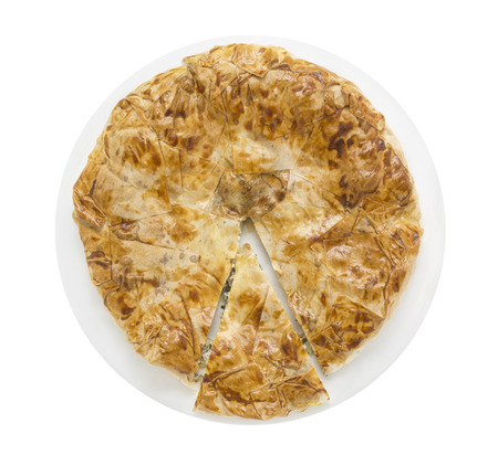 filo pastry: Burek, filo pastry in white plate with cutting pieces , isolated