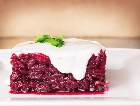 sideview: Beet salad with sour cream, square shape, sideview Stock Photo