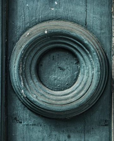 elliptic: Round element of the old wooden walls painted in dark turquoise color background Stock Photo