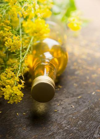 oil rape: Rapeseed Oil with fresh rape plant close up