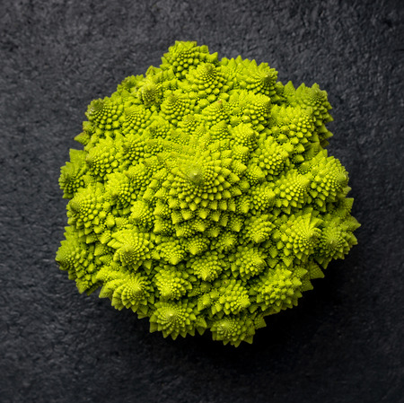 background color: Romanesco cabbage on dark background top view Stock Photo