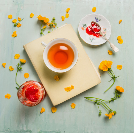 Breakfast with cup of tea and flowers on facebook jam rustic wooden background Top View Stock Photo