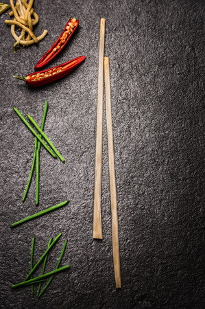 Dark background asian food with chopstick chili noodles and top view Reklamní fotografie