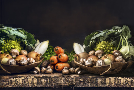 vegetable background: Fresh organic vegetables from garden on old rustic wooden table, vegetarian cooking concept