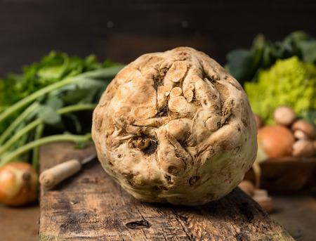 celeriac: Fresh celeriac on rustic wooden background, close up