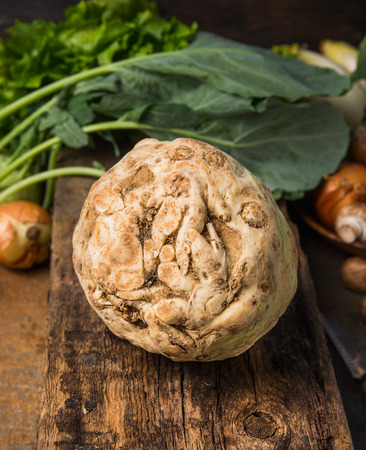 celeriac: Fresh celeriac with knife on old rustic wooden table, close up Stock Photo