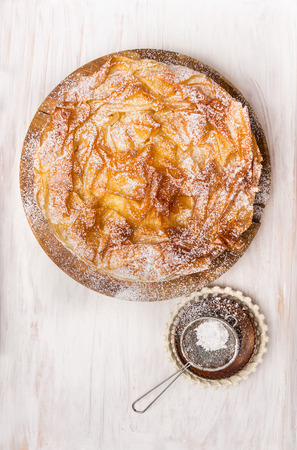 filo pastry: Sweet Filo pastry cake  and  Sifter Spoon, top view Stock Photo