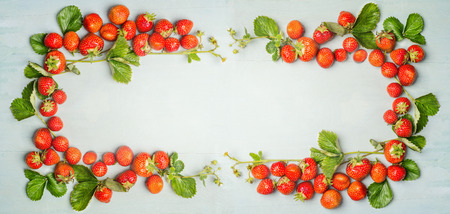 strawberries frame on wooden background, top view, banner for website