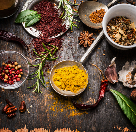 herbs white background: Herbs and spices selection with curry and staghorn sumac powder , close up