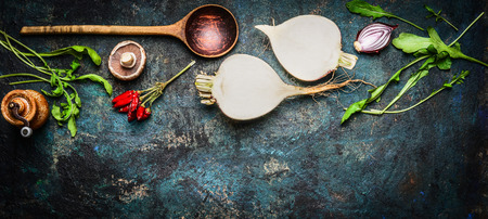 Root vegetables with wooden spoon and fresh ingredients for cooking healthily on rustic background, top view, banner. Vegan or diet food concept Foto de archivo