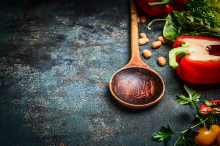 close up food: Old wooden spoon and fresh vegetables for tasty vegan cooking on rustic background, close up Healthy food or diet concept.
