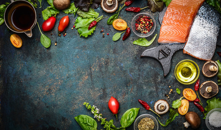 gourmet meal: Salmon fillet with fresh ingredients for tasty cooking on rustic background, top view, banner. Healthy food concept