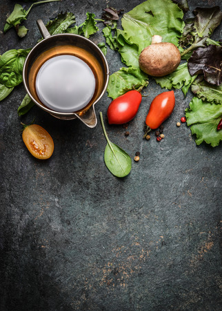 italian cuisine: Fresh ingredients for salad making on rustic wooden background, top view, border Stock Photo