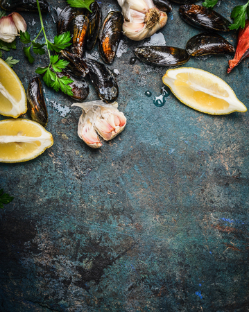 seafood: mussels with lemon and ingredients for cooking , top view, place for text. Seafood concept