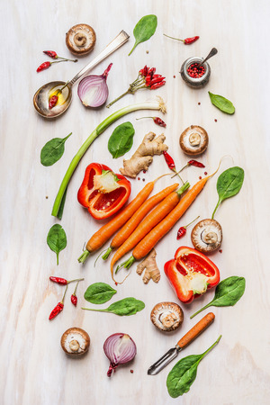 vegan food: Colorful vegetables ingredients for healthy cooking. Composing on white wooden background. Vegan nutrition and diet food concept. Top view