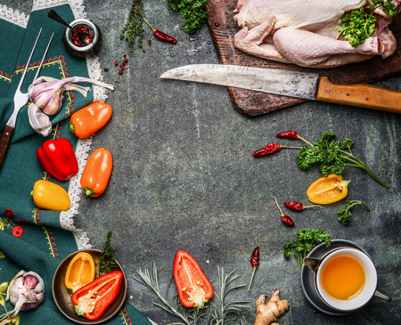 aceite de cocina: Raw whole chicken with oil and vegetables ingredients for cooking on rustic background, frame, top view.  Healthy food or diet eating concept.
