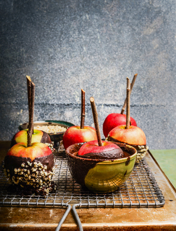 Apples covered with melted chocolate and almond