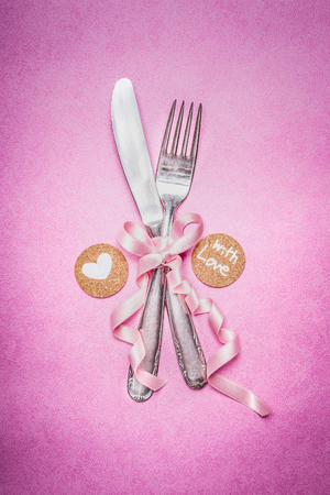 Pink romantic table place setting with sign decoration and message for you and heart , top view, close up. Valentines day and love concept.