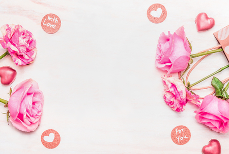 Valentines day card with roses, chocolate and love Message on white wooden background, top view, frame Zdjęcie Seryjne