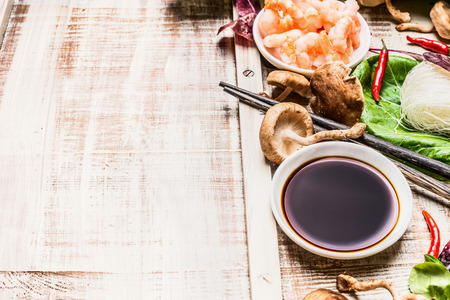 teriyaki: Soy sauce asian cooking ingredients on rustic wooden background, place for text.