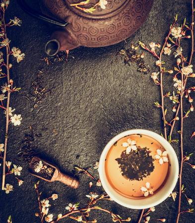 Asian tea set with Iron Teapot and jasmine blossom on vintage rustic background, top view, frame Stok Fotoğraf