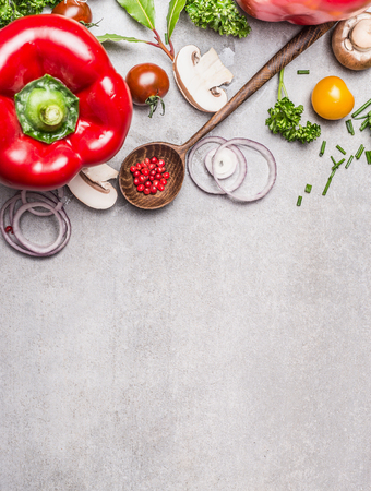 Wooden Spoon and Healthy vegetables and seasoning ingredients for fresh  tasty cooking on gray stone background, top view composing. Healthy eating and diet food concept. Zdjęcie Seryjne