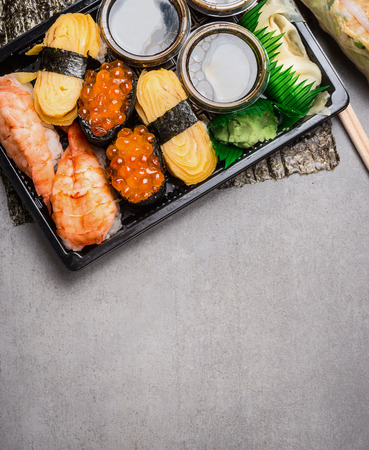 uni: Sushi set with nigiri and uni ikura on gray stone background, top view, place for text Stock Photo