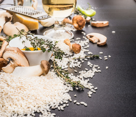 preparation: Mushrooms risotto preparation with ingredients for cooking . Italian food concept Stock Photo