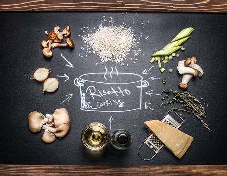 risotto: Cooking Ingredients for mushrooms risotto with  hand drawings on dark chalkboard. Italian food