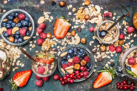 Healthy breakfast ingredients: muesli, various berries , nuts and seed. Healthy breakfast in glass jar. Detox and Clean food concept. Stock Photo