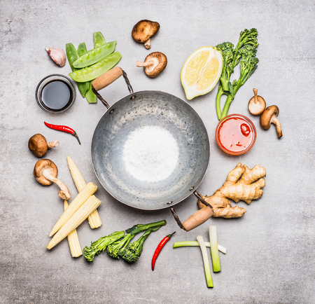 sliced: Blank Wok pan and ingredients for Chinese or Thai  cooking , top view. Asian cuisine Stock Photo