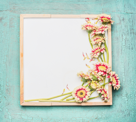 photo frame: Blank  white chalkboard and pretty flowers bunch on turquoise shabby chic background, top view Stock Photo