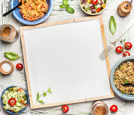 Various healthy vegetarian salads bowls around blank white chalkboard, top view. Salad bar. Food background for menu, recipes or your text Zdjęcie Seryjne - 56320886
