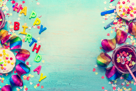 Happy birthday party background with text, drinks, cupcake and colorful tools, top view. Happy birthday greeting card 写真素材
