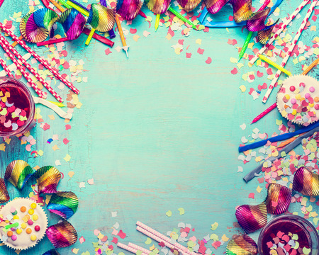 Happy birthday frame. Party tools with cake, drinks and confetti on turquoise shabby chic background, top view, place for text. Happy birthday greeting card 写真素材