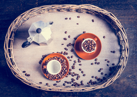 kopitiam: Espresso set with coffee cups, beans and coffee pot on rustic tree and wooden background, top view